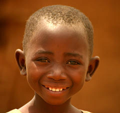 Young refugee smile, by TKnoxB, on Flickr